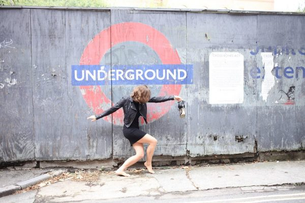 Polly Trope in front of London subway